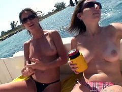 Touch yourself watching these brunette cougars, with natural boobs wearing bikinis, while they have lesbian sex and go wild together.