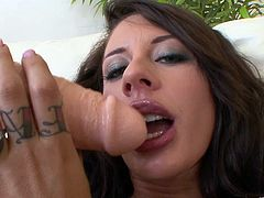 Broad sticks a big cock-shaped dildo in her fuckin' gash
