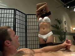 Yasmin Lee shows Cameron some pictures of sex positions they could try and his cock gets really hard. She strokes his meat for a bit and then the two head to the bedroom for some sex. He jacks off while she gets undressed and she waves her dick in his face and makes him suck it. She shoves it in.