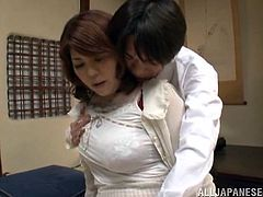 Busty Japanese mom Miyuki Yokoyam lets some guy play with her massive natural jugs. Then they fuck doggy style and in missionary positions and Miyuki moans loudly with pleasure.