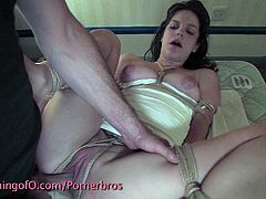 Gorgeous brunette babe is tied up and forced to suck cock hard and deep. She bends over and gets her pussy fuckd hard apart from other nasty punishments, you can't miss it if you're into BDSM.