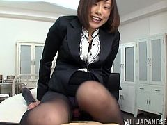 Get a hard dick watching this Asian brunette, with a nice ass wearing a miniskirt and nylon pantyhose, while she goes really hardcore.