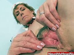 Freaky head nurse sitting on gynochair and playing with various toys like plastic penis and vagina spreader. Also uses a gyno mirror to explore her aged cunny