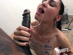 A White chick in lace lingerie gets her body covered with writing by a Black guy. Then this sexy chick gives a handjob and a blowjob to him.