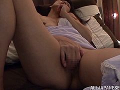 This horny Asian woman in panties and a negligee masturbates before going to sleep. It really helps her to avoid an insomnia. She fingers her pussy intensively to cum as fast as possible.