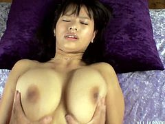 This sexy Japanese girl shows off her huge melons when she climbs on top and bounces on this lucky guy's rock hard cock.