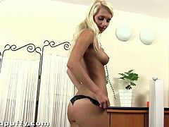 Slender Uma takes off her clothes. This pleasurable babe shows off her nice tits and fingers the pussy. Uma drills her cunt with different sex toys lying on a table and a floor.