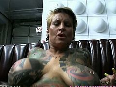 This extravagant slut is everything your cock desires. Her tattooed body and pierced pussy look great while she gets fucked missionary style.
