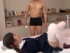 Amirable pigtailed Japanese college girl shows her smooth vagina to some man and lets him rub it with a dildo. Then they fuck doggy style and in missionary position and seem to be unable to stop.