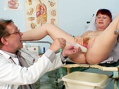 Olga goes to the gyno where she gets her hairy twat fully stretched