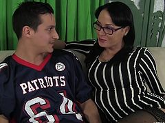 This dark haired goddess has an affinity for rock hard pecker. She undoes her son's friend's pants, before the big high school football match. He is shocked to learn, she wants to suck his dick, but she is really good at it. He licks her nipples, to make her pussy nice and moist.