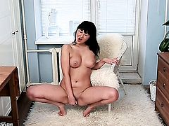 Vanessa Vaughn does striptease before she sticks her fingers in her honeypot