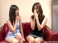 Asian lesbians kiss lying on a sofa. They get so damn horny that take off clothes. The girls eat each others appetizing pussies with pleasure.