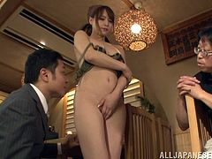 This Japanese milf is made to take all her clothes off, by her husband and play a show for him and his friend. She kisses her man and then, he opens up her legs, to finger that super hairy vagina she had.