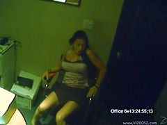Hidden camera shows a hottie masturbating in the office