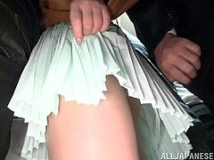 Cute Akiho Yoshizawa has sex in an overcrowded subway train. Some dude lifts her skirt up and fondles the pussy. He makes a hole in pantyhose and starts to fuck the girl.