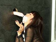 This beauty is covered in jizz after enjoying true glory hole porn