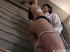 Slim and sexy Japanese chick gets tied up by her boss. This man licks and toys her vagina. The girl gets very horny, so the man unties her. She rides a dick passionately and also sucks it.