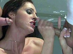 Redhead Lauren Phoenix gets banged by two guys in a classroom. Sizzling teacher gives a blowjob and gets fucked in her cunt at the same time. Nothing can be better than this. Guys also feed the MILF with their high calorie yogurt.