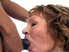 Naughty granny with insatiable sex hunger fucks in outrageous interracial porn scene. She rides BBC while sucking two other big cocks in turn.