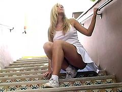 Red hot blonde Alison Angel lifts up her skirt, pulls off her panties and shows her amazing ass while she goes out for a walk.