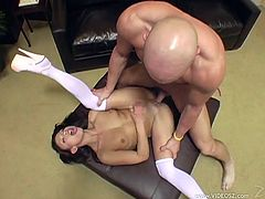 A nice chick in a miniskirt and stockings gets banged on a couch. A bald dude fucks Jayna in her shaved pussy and tight ass.