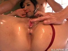 Take a nice look at this Asian babe, with a nice ass wearing a red baiting suit, while she goes hardcore covered in oil in a crazy FFM.