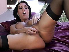 Dylan Ryder with giant breasts and shaved twat makes her sexual fantasies come true in solo scene