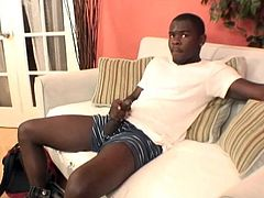 A lustful black poofter wearing shorts is having fun indoors. He strokes and massages his weiner and moans with pleasure all the time.