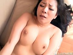 Horny Japanese mom is playing dirty games with some dude indoors. She lets the man kiss her big tits and then moves her legs wide apart and enjoys passionate fingering.