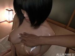 A gorgeous Japanese hottie sucks on a hard cock and gets it shoved balls deep into her oiled up fuckin' pussy, check it out!
