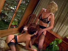 Horny and sexy whores with nice bodies and in sexy lingerie shows their clits. One of them gets her clit licked by the other one standing with spreaded legs. Watch in The Classic Porn sex clip.
