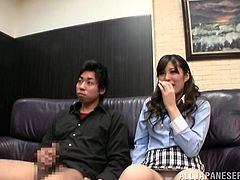 Slutty Japanese milf Mao Hamasaki is playing dirty games with some nerd indoors. Mao fingers her pussy ardently and then shows her handjob skills to the guy.