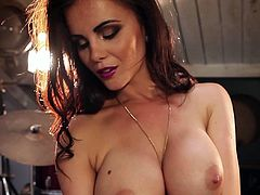 Get wild watching this brunette babe, with giant gazongas wearing sexy lingerie, while she moves erotically surrounded by music instruments.