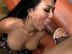 This Hawaiian beauty lays back on the couch and fingers her pussy in front of her black boyfriend. She fingers herself deep and he licks her asshole and pussy from behind. She sucks his massive black member and gets a jizz load.