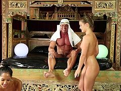 The sultan has a vast empire of wealth; this affords him the opportunity to sit back and relax as his sex slaves give him an erotic rubdown. The women start off by kissing him, but soon things get much more naughty. They rub his aching muscles and suck his cock.