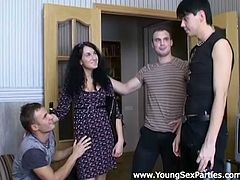 Filthy dark head bitch takes off her clothes in front of three horny studs. She lies on top of the table letting kinky dudes play with her privates.