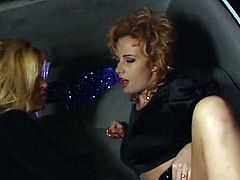 Get a load of this hot lesbian scene where these horny blondes have an amazing time fucking each other with a strapon inside a limousine.