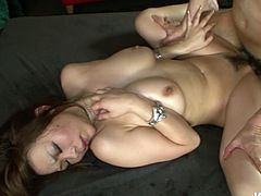 Full bodied Asian MILF Ren gives awesome titjob. Then she is fucked in a missionary position. After, she is banged hard in doggy position while sucking hard dick deepthroat. Kinky Jap slut gets pussy creampied.