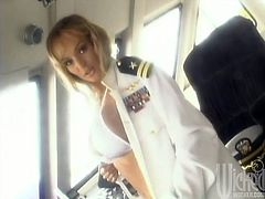 A charming blonde in a naval officer uniform masturbates on a captain's bridge. Tanya shows off her boobs and licks a golden dildo. She toys the pussy and licks her pussy juices off the dildo.