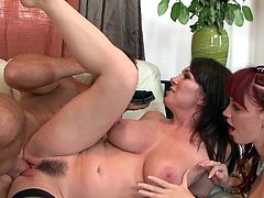 Marie McCray and Rayveness are giving a blowjob