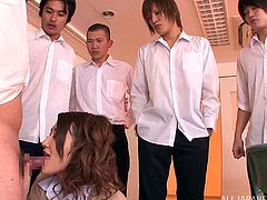 This sexy Japanese teacher has kept the unruly boys in her class after school so she can discipline them. What will their punishment be? Well, They have to whip their cocks out so she can inspect them. She sucks of the students and works multiple dicks at once.