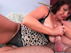 Checkout this sexy brunette busty granny named as Alma.See how this sexy busty granny, strips off her clothes and shows her hairy cunt for young hard cock, which she sucks and rides it till he cums on her face.