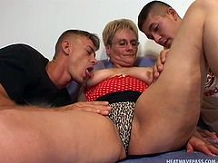 This granny is going to make two young guys with a granny fetish very happy. She spreads her legs open wide and lets them finger her. After she is nice and horny she takes turns sucking each of their rock hard erections.