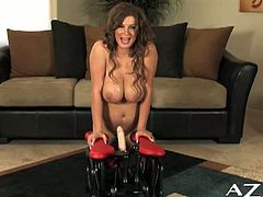 This type of sybian is called the Rocker. It's Sara Stone's first time with it, so she takes it slow.