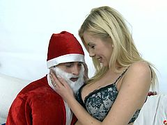 Donna Bell was sleeping when Santa Clause arrived with a huge gift for her. She woke up and thanked him with a blowjob and by riding his cock with her tight ass hole.
