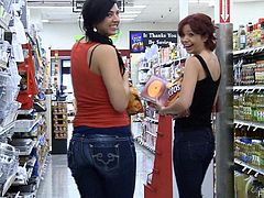 While in the grocery store, these two babes pull down their tight jeans and flash their sweet round asses right there in public.
