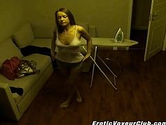 A hidden camera records everything. An amateur girl irons her clothes. This girl in panties changes her clothes and goes outside.