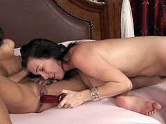 Watch how the toy slides perfectly up their creamy vags