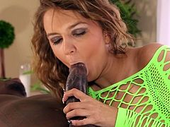 Her warm lips are sliding perfectly up and down this large snake during interracial cock sucking show
